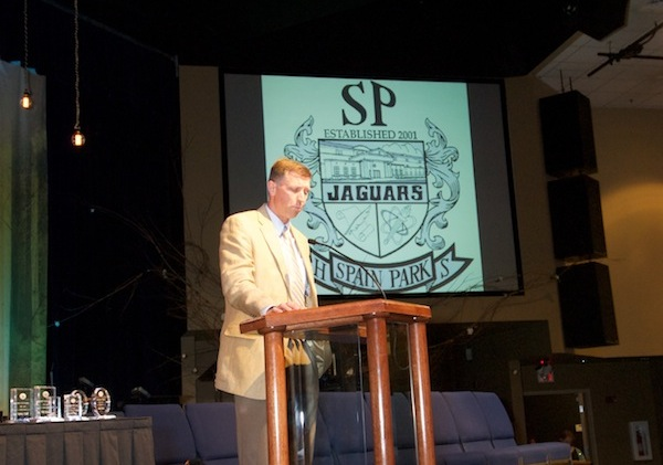 Managing Director Craig Sorensen announces the scholarship winner at Spain Park High School, Justin Thai.