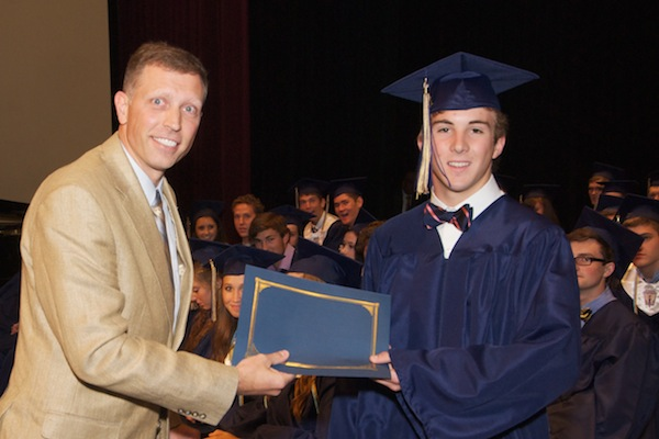 Mr. Sorensen presents John Mason IV with his SouthWest Water Company scholarship award certificate. John graduated from Briarwood Christian School.