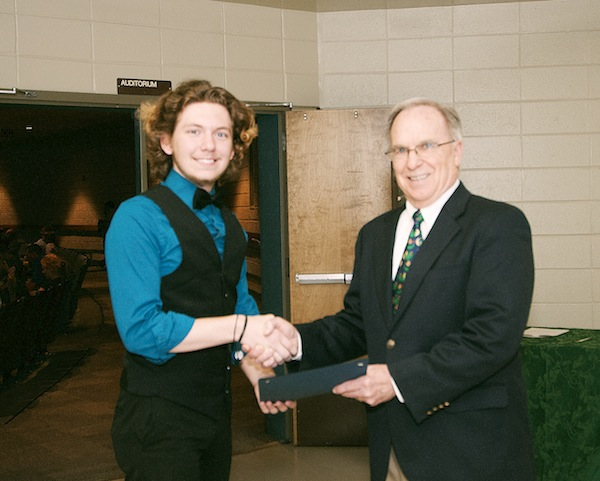 Kane Agan, of Pelham High School, accepts his scholarship award certificate from Ed Becker, Director of Business Development for SouthWest Water Company