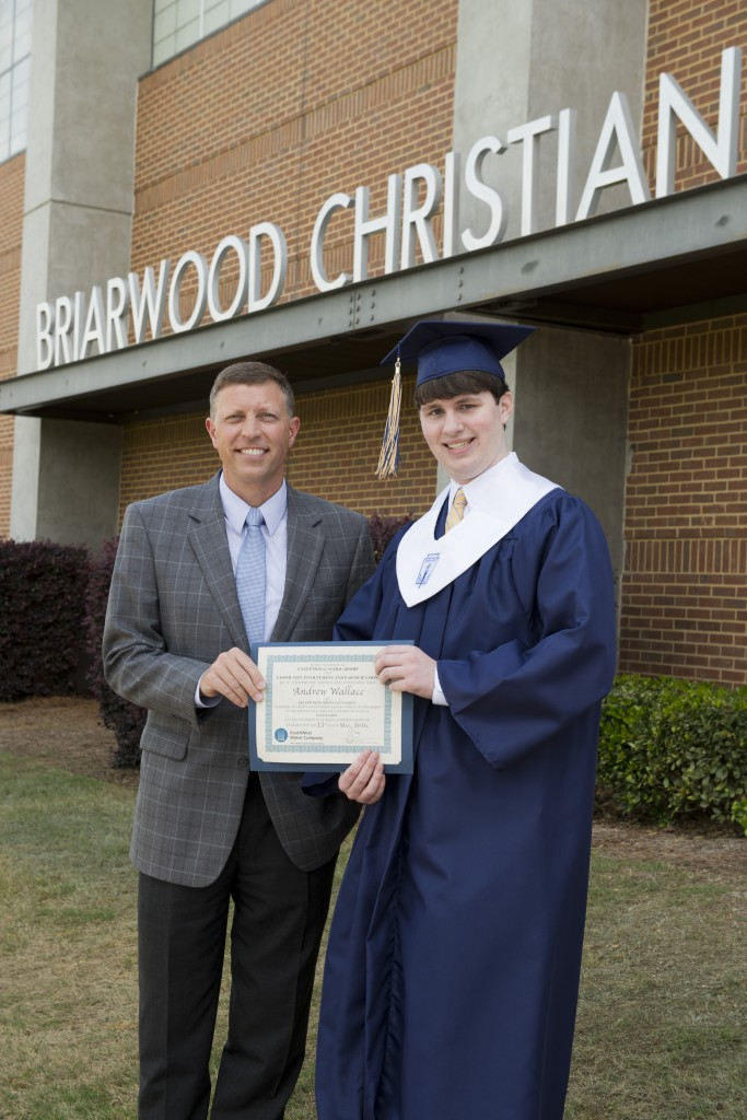 Craig Sorensen (L), Managing Director of SouthWest Water Company, presents the SWWC scholarship to Andrew Wallace (R), Briarwood Christian School. Andrew will study general engineering at the University of Alabama at Birmingham.