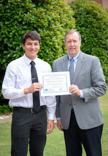 Harry Chandler (R), of SouthWest Water Company, presents the SWWC scholarship to Heath James Nunn (L), Briarwood Christian School. Heath will study engineering at Auburn University.