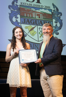 Shane Campbell (R), of SouthWest Water Company, presents the SWWC scholarship to Halle Hoagland (L), Spain Park High School. Halle will study chemical engineering at Auburn University.