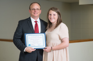 Guy Locker (L), of SouthWest Water Company, presents the SWWC scholarship to Gracyn LeSueur (R), Pelham High School. Gracyn will study biomedical engineering at Mississippi State University.